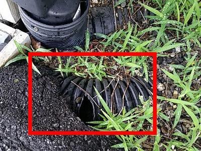 damaged downspout drain